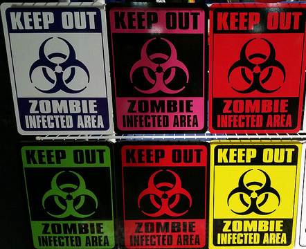 Six warning signs, all stating 'Keep Out - Zombie Infected Area'