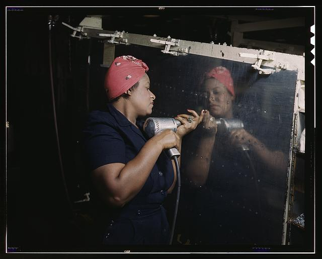 African American woman working on a World War II dive bomber