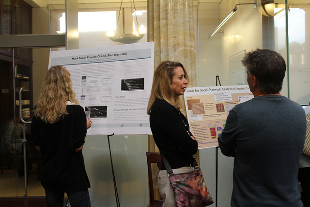 People examining research posters at a poster session
